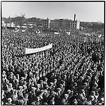 """People's Liberation Army soldiers shout """"Down with Deng Xiaoping"""" and carry a banner that reads: """"Denounce with indignation the crimes of Deng Xiaoping"""" at the renamed People's Stadium; Harbin, Heilongjiang Province, April 9, 1976"""