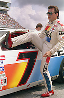 Alan Kulwicki climbs into car qualifying Pepsi 400 at Daytona International Speedway in Daytona beach, FL on July 1, 1989. (Photo by Brian Cleary/www.bcpix.com)
