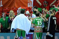 Siarhei Rutenka and Dzianis Rutenka  celebrating victory against South Korea with belarus fans