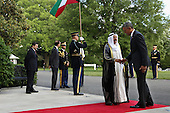 United States President Barack Obama (R) welcomes Sheikh Sabah Al-Ahmed Al-Jaber Al-Sabah, Amir of the State of Kuwait, to the White House May 13, 2015 in Washington, DC. Obama is hosting a summit of the Persian Gulf countries in Washington and at Camp David tomorrow.  <br /> Credit: Chip Somodevilla / Pool via CNP