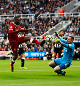 1st October 2017, St James Park, Newcastle upon Tyne, England; EPL Premier League football, Newcastle United versus Liverpool; Daniel Sturridge of Liverpool is stopped by a brave save from Robert Elliot of Newcastle United in the 1-1 draw