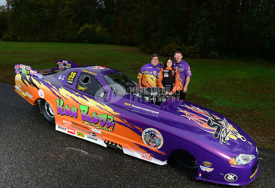 Oct. 7, 2012; Mohnton, PA, USA: NHRA top alcohol funny car driver Cassie Simonton and crew during qualifying for the Auto Plus Nationals at Maple Grove Raceway. Mandatory Credit: Mark J. Rebilas-
