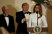 United States President Donald J. Trump gestures behind First Lady Melania Trump as US Vice President Mike Pence looks on at the Congressional Ball at White House in Washington on December 15, 2018. <br /> Credit: Yuri Gripas / Pool via CNP