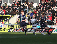 (left to right) Scott Boyd, Sam Parkin and Grant Munro battle for the ball in the St Mirren v Ross County Clydesdale Bank Scottish Premier League match played at St Mirren Park, Paisley on 19.1.13.