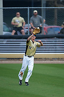 UCF Knights center fielder Luke Hamblin (12) catches a fly ball during a game against the Siena Saints on February 21, 2016 at Jay Bergman Field in Orlando, Florida.  UCF defeated Siena 11-2.  (Mike Janes/Four Seam Images)