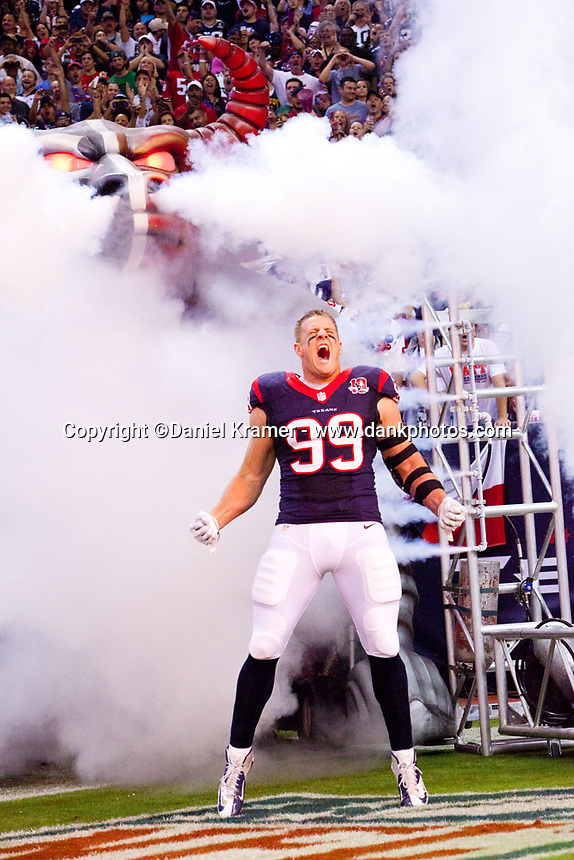 """JJ Watt makes his customary entrance during the Houston Texans """"Bulls on Parade"""" introductions prior to the Oct. 12, 2013 game against the Green Bay Packers at Reliant Stadium in Houston, TX."""