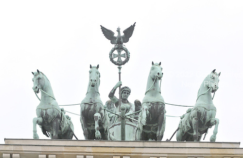 Berlin, Germany - August 11, 2009 -- Statue of Quadriga, a chariot drawn by four horses driven by Victoria, the Roman goddess of victory, that sits atop the Brandenburg Gate in Berlin, Germany on Tuesday, August 11, 2009.  This is the view looking west from the former East Berlin..Credit: Ron Sachs / CNP