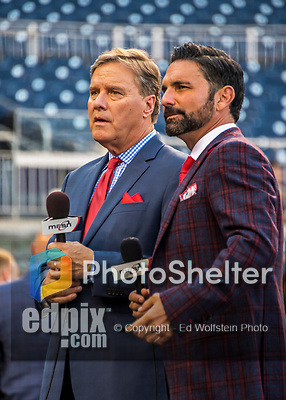 6 October 2017: Washington Nationals MASN broadcasters Bob Carpenter and F.P. Santangelo prepare to file a report during batting practice prior to the NLDS Game 1 against the Chicago Cubs at Nationals Park in Washington, DC. The Cubs shut out the Nationals 3-0 to take a 1-0 lead in their best of five Postseason series. Mandatory Credit: Ed Wolfstein Photo *** RAW (NEF) Image File Available ***