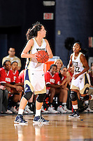 28 January 2012:  FIU guard Fanni Hutlassa (10) handles the ball in the first half as the FIU Golden Panthers defeated the Western Kentucky University Hilltoppers, 60-56, at the U.S. Century Bank Arena in Miami, Florida.