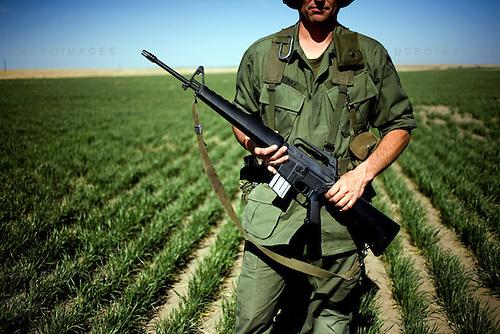 Twins Sam and Dan Steinke of Culbertson, Nebraska dressed in Vietnam-era uniforms complete with authetic M16 A1 rifles.  Rocky Mountain Fifty Caliber Shooting Association Machine Gun Shoot, Cheyenne Wells, Colo.