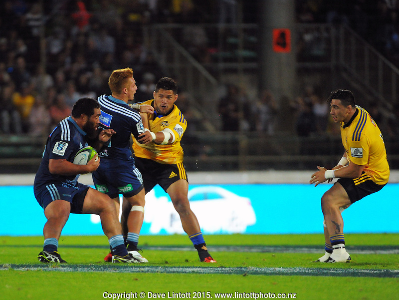 Ihaia West blocks Chris Eves from Charles Faumuina during the Super Rugby match between the Hurricanes and Blues at FMG Stadium, Palmerston North, New Zealand on Friday, 13 March 2015. Photo: Dave Lintott / lintottphoto.co.nz