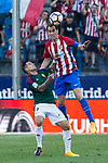 Sergio Leon of Club Atletico Osasuna competes for the ball with Diego Godin of Atletico de Madrid during the match of La Liga between  Atletico de Madrid and Club Atletico Osasuna at Vicente Calderon  Stadium  in Madrid, Spain. April 15, 2017. (ALTERPHOTOS / Rodrigo Jimenez)