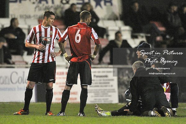 Players look on as Elliot Styles (Hornchurch captain) receives treatment. AFC Hornchurch Vs Colchester United. Essex Senior Cup. Fifth (5th) Round.The Stadium. Essex. 08/01/2013. MANDATORY Credit Garry Bowden/Sportinpictures - NO UNAUTHORISED USE - 07837 394578