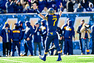 Morgantown, WV - NOV 10, 2018: West Virginia Mountaineers quarterback Will Grier (7) walks off the field signaling a touchdown after late 2nd quarter score of game between West Virginia and TCU at Mountaineer Field at Milan Puskar Stadium Morgantown, West Virginia. (Photo by Phil Peters/Media Images International)