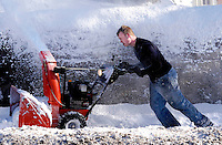 Andrew Young of Doylestown, Pennsylvania pushes a snow blower after a winter snow storm December 9, 2005 in Doylestown, Pennsylvania. The Philadelphia region was hit with alomst 8 inches of snow, closing schools and some businesses. Photo by William Thomas Cain / photodx.com