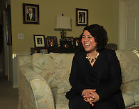 NWA Democrat-Gazette/Michael Woods --01/14/2015-- w @NWAMICHAELW... L. Mireya Reith, executive director of the Arkansas United Community Coalition, talks to a reporter during an interview Tuesday afternon at her home office in Fayetteville.