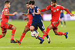 Minamino Takumi of Japan (C) is tackled by Mohammed Al Musallami (L), Harib Al Saadi (2nd L) and Khalid Al Braiki of Oman (R) during the AFC Asian Cup UAE 2019 Group F match between Oman (OMA) and Japan (JPN) at Zayed Sports City Stadium on 13 January 2019 in Abu Dhabi, United Arab Emirates. Photo by Marcio Rodrigo Machado / Power Sport Images