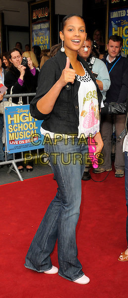 "ALESHA DIXON .Attending the ""High School Musical"" stage show Press Night at the Hammersmith Apollo Theatre, London, England, UK, July 5th 2008..outside arrivals full length pink clutch bag white top jeans black jacket thumb up shoes.CAP/CAN.©Can Nguyen/Capital Pictures"