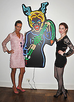 "Esmé Bianco (right) & Lady Victoria Hervey at reception for Amanda Eliasch's neon art exhibition ""Peccadilloes"" at the Leadapron Gallery, West Hollywood..June 16, 2011  Los Angeles, CA.Picture: Paul Smith / Featureflash"
