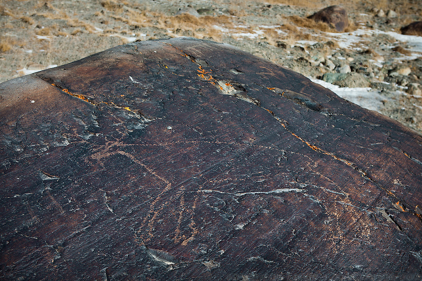 Ancient rock petroglyph depicting a large animal that looks like a deer..Near Bozoi Gumbaz..On the Little Pamir plateau.