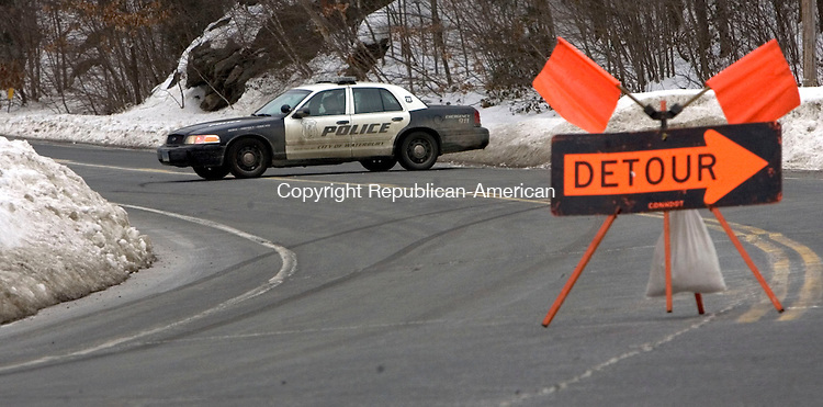THOMASTON CT. 14 February 2015-021415SV02-Waterbury police block the road at the Thomaston line as crews check out a water main break on Waterbury Road in Thomaston Saturday. The water break is just north of City Limits caf&eacute;. <br /> Steven Valenti Republican-American