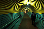A worker of the nickel factory of Norilsk Nickel in the Artic city of Norilsk in the far north of Russia walked through a covered overpass, used to protect workers from the bitter winter weather, towards the electrolysis section of the factory. June 13, 2007