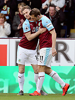 Burnley's Chris Wood (right) celebrates with team-mate Ashley Barnes as he celebrates scoring the opening goal <br /> <br /> Photographer Rich Linley/CameraSport<br /> <br /> The Premier League - Burnley v Wolverhampton Wanderers - Saturday 30th March 2019 - Turf Moor - Burnley<br /> <br /> World Copyright © 2019 CameraSport. All rights reserved. 43 Linden Ave. Countesthorpe. Leicester. England. LE8 5PG - Tel: +44 (0) 116 277 4147 - admin@camerasport.com - www.camerasport.com
