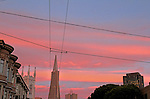 A sunset lights up San Francisco skyline as seen from the Northbeach district of San Francisco, CA