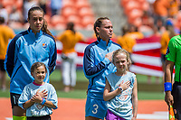 Houston, TX - Saturday May 13, Sky Blue players Kailen Sheridan and Christie Pearce stand for the national anthem during a regular season National Women's Soccer League (NWSL) match between the Houston Dash and Sky Blue FC at BBVA Compass Stadium. Sky Blue won the game 3-1.