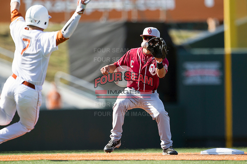 Oklahoma Sooners shortstop Jack Mayfield #8 catches a throw from the catcher as Texas Longhorns baserunner Weston Hall #7 slides into second base during an attempted steal in the NCAA baseball game on April 6, 2013 at UFCU DischFalk Field in Austin, Texas. The Longhorns defeated the rival Sooners 1-0. (Andrew Woolley/Four Seam Images).