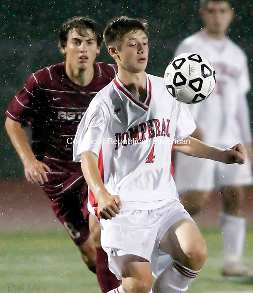 Southbury, CT-15 October 2012-101512CM10-  Pomperaug's Zach Paulisin (4) controls the ball as Bethel's Patrick McCourt, left, looks on during SWC boys soccer Monday night in Southbury.  Pomperaug edged out Bethel, 2-1.   Christopher Massa Republican-American
