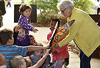 NWA Democrat-Gazette/DAVID GOTTSCHALK Students in Karen Swalley's third grade class at Bernice Young Elementary School in Springdale reach out to touch the body of a butterfly Friday, October 4, 2019, held by Chris Bell, a Butterfly Nanny at the Botanical Garden of the Ozarks, during Butterfly Days 2019 at the garden in Fayetteville. The two day event featured learning stations that covered subjects that included butterfly life cycles, structures and functions of insects.