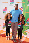 LOS ANGELES, CA- JULY 17: Former NFL player Michael Strahan (C) and daughters Isabella Strahan and Sophia Strahan attend Nickelodeon Kids' Choice Sports Awards 2014 at Pauley Pavilion on July 17, 2014 in Los Angeles, California.