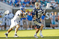 February 20, 2011:  Notre Dame midfield Zach Brenneman (28) tries to evade the attack of Duke midfielder Terrence Molinari (32) during Lacrosse action between the Duke Blue Devils and Notre Dame Fighting Irish during the Moe's Southwest SunShine Classic played at EverBank Field in Jacksonville, Florida. Notre Dame defeated Duke 12-7.