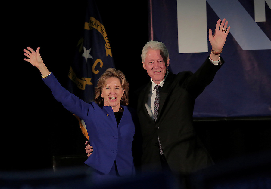RALEIGH, NC - OCTOBER 31:  Former president Bill Clinton and North Carolina's Democratic incumbent for U.S. Senate Kay Hagan wave to the crowd at a campaign event at Broughton High School in Raleigh, NC, on Friday, October 31, 2014.  (Photo by Ted Richardson/For The Washington Post)