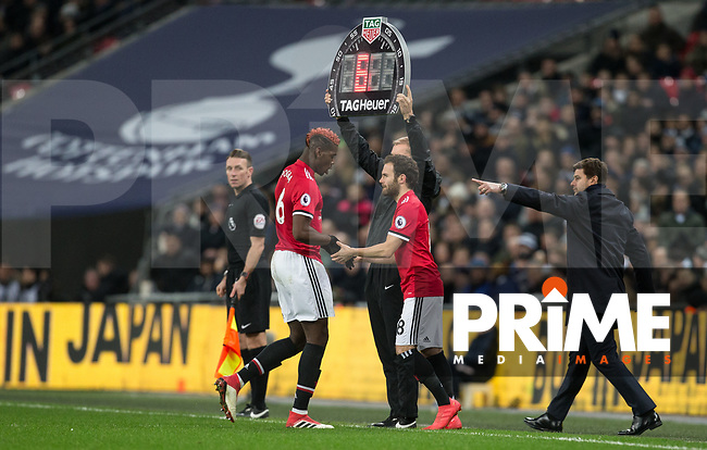 Juan Mata of Man Utd replaces Paul Pogba of Man Utd during the Premier League match between Tottenham Hotspur and Manchester United at Wembley Stadium, London, England on 31 January 2018. Photo by Andy Rowland.