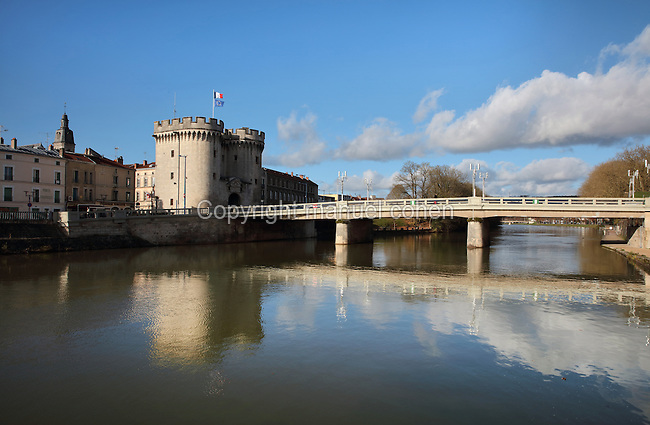 The Porte Chaussee or Causeway Tower, built 1380 in Gothic style, on the banks of the river Meuse, Verdun, Meuse, Lorraine, France. The tower formed part of the defensive ramparts of Verdun, with 2 circular towers with crenellated battlements. Picture by Manuel Cohen