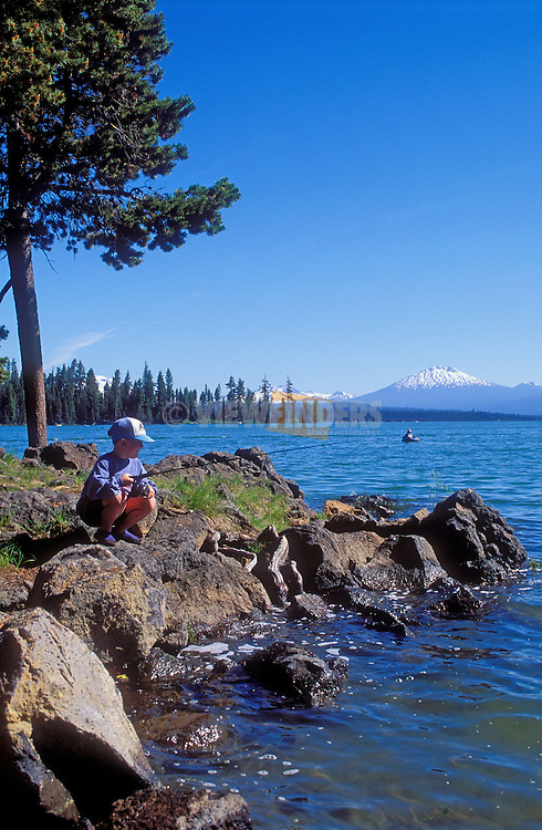 Dallas Harper of Prineville fishing at Crane Prairie Reservoir, with Mt. Bachelor in the distance; Cascade Mountains, Oregon..#2364-3112