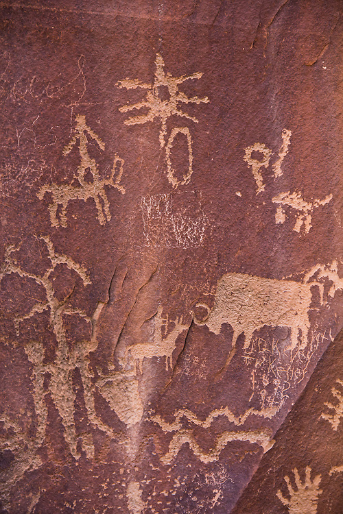 Indian petroglyphs, Newspaper Rock, Canyonlands area, Utah, one of the best accessible Southwest Ancestral Puebloan, collection of rock carvings, State Historical Monument near US 191,