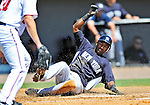 12 March 2011: New York Yankees' infielder Eduardo Nunez slides home safely during a Spring Training game against the Washington Nationals at Space Coast Stadium in Viera, Florida. The Nationals edged out the Yankees 6-5 in Grapefruit League action. Mandatory Credit: Ed Wolfstein Photo