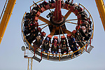 Palestinians take a ride at an amusement park on the third day of Eid al-Fitr holiday which marks the end of the Muslim holy month of Ramadan, in Gaza City on June 27, 2017. Photo by Ashraf Amra