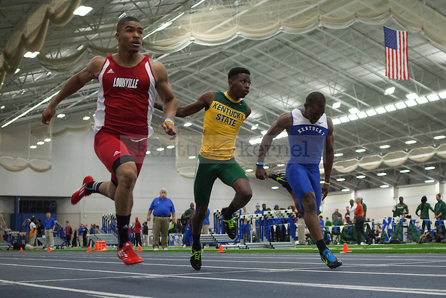Louisville senior Macellus Hobbs (left), KY State freshman Rahsaan Allen (center), and UK sophomore Gabriel Henry (right) in the men's 60 meter dash during the UK Invitational Track & Field Meet on January 12th, 2013 at the Nutter Field House. Photo by Adam Chaffins | Staff