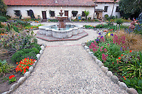Gardens and fountain at the Carmel Mission. Carmel by the Sea, California.