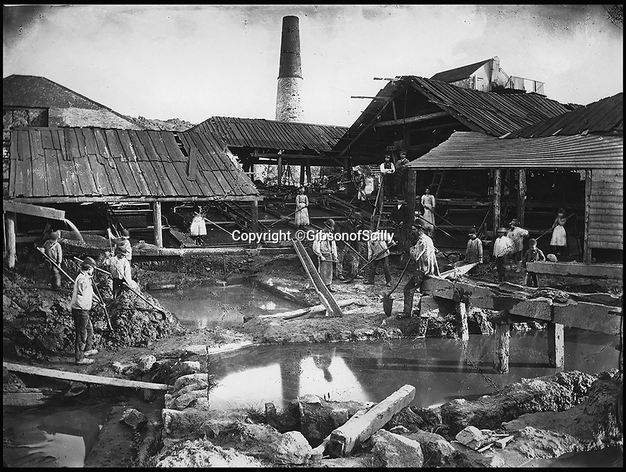BNPS.co.uk (01202 558833)<br /> Pic: GibsonOfScilly/BNPS<br /> <br /> Consolidated Mine in St Ives, 1885.<br /> <br /> An archive of eye-opening photographs documenting the grim reality of Poldark's Cornwall has emerged for sale for &pound;25,000.<br /> <br /> More than 1,500 black and white images show the gritty lives lived by poverty-stricken families in late 19th and early 20th century Cornwall - around the same time that Winston Graham's famous Poldark novels were set.<br /> <br /> The collection reveals the lowly beginnings of towns like Rock, Fowey, Newquay and St Ives long before they became picture-postcard tourist hotspots.<br /> <br /> Images show young filth-covered children playing barefoot in squalid streets, impoverished families standing around outside the local tax office, and weather-beaten fishwives tending to the day's catch.<br /> <br /> The Cornish archive, comprising 1,200 original photographic prints and 300 glass negative plates, is tipped to fetch &pound;25,000 when it goes under the hammer as one lot at Penzance Auction House.