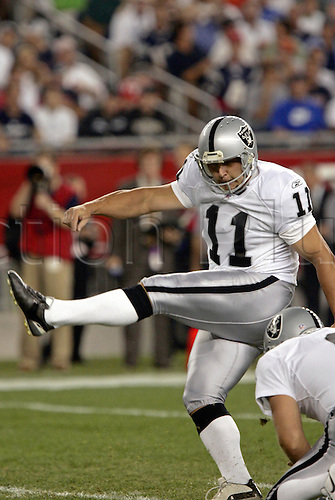8 September 2005: Oakland Raiders field goal kicker Sebastian Janikowski kicks an extra point during the game between the New England Patriots and the Oakland Raiders in Foxboro, MA. The Patriots won 30-20 to continue their home winning streak. Photo: Robert E. Klein/actionplus...nfl 050908 gridiron player