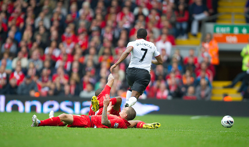 Liverpool's Daniel Agger collides with a team-mate resulting in him being carried off injured, meanwhile Manchester United's Luis Antonio Valencia sprints away only to be fouled in the penalty area resulting in Robin van Persie securing a 2-1 victory for Manchester United..Football - Barclays Premiership - Liverpool v Manchester United - Sunday 23rd September 2012 - Anfield - Liverpool..