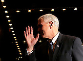 United States Vice President Elect Mike Pence waves after he speaks to the press as he exits Trump Tower on December 5, 2016 in New York City. U.S. President-elect Donald Trump is still holding meetings upstairs at Trump Tower as he continues to fill in key positions in his new administration.    <br /> Credit:John Angelillo / Pool via CNP