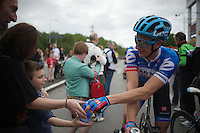 Linus Gerdemann (GER/Garmin-Sharp) hands out his bidon after the race to a kid watching the riders come in<br /> <br /> Liège-Bastogne-Liège 2014