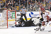 Steven Whitney (BC - 21) scores the only third period goal on Alex Beaudry (PC - 35). - The Boston College Eagles defeated the Providence College Friars 4-2 in their Hockey East semi-final on Friday, March 16, 2012, at TD Garden in Boston, Massachusetts.
