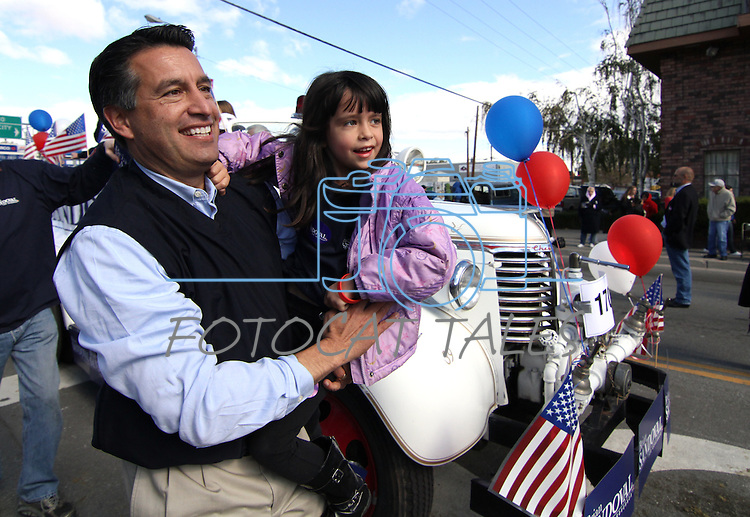 Republican gubernatorial candiate Brian Sandoval carries his daughter Marisa, 6, during the Nevada Day parade on Saturday, Oct. 30, 2010, in Carson City, Nev. .Photo by Cathleen Allison